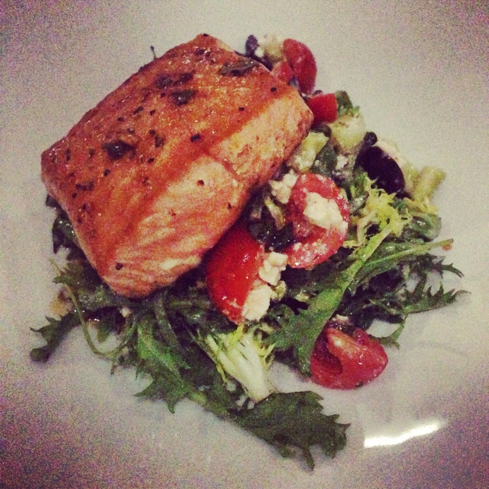 Salmon over Frisee Greek Salad