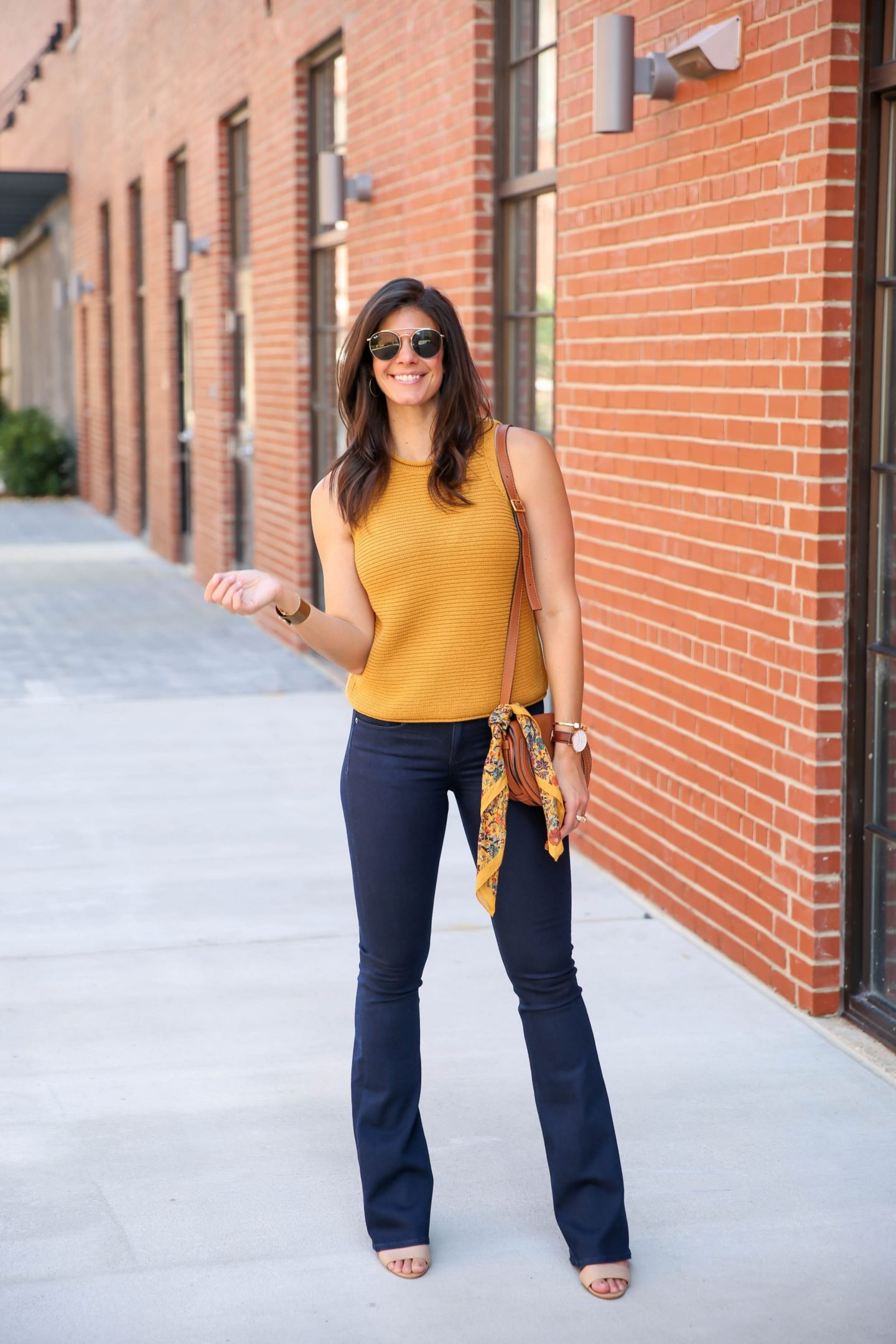 70s style for fall - mustard sweater tank - denim flares - Lauren schwaiger style blog