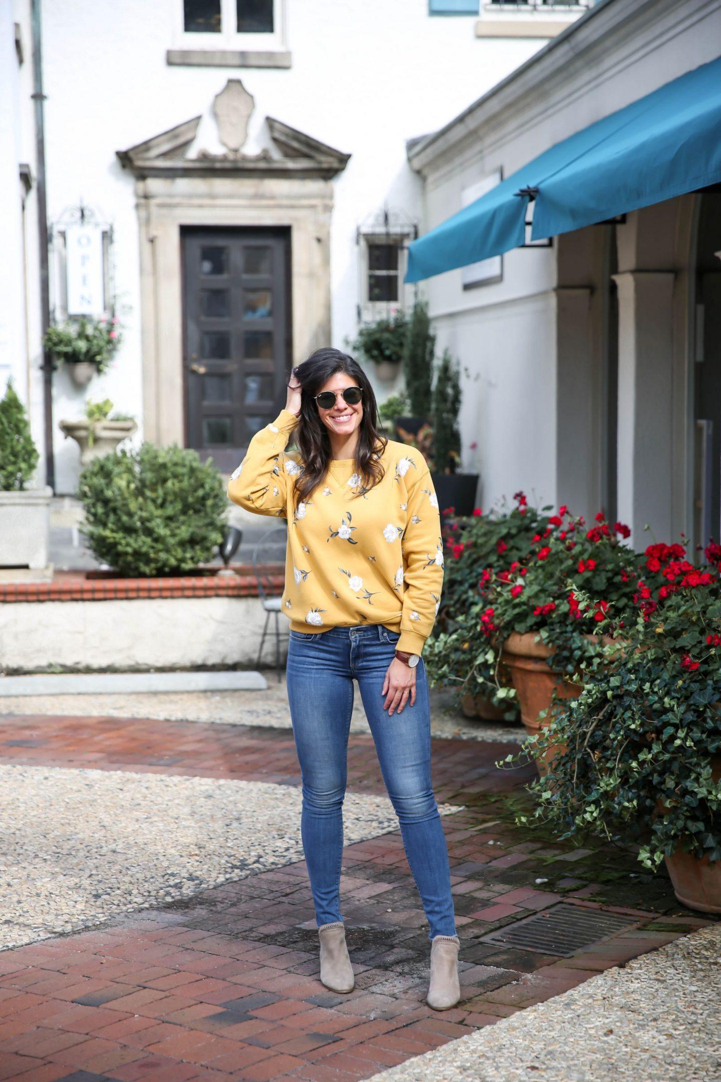 floral sweatshirt - skinny jeans - ankle booties