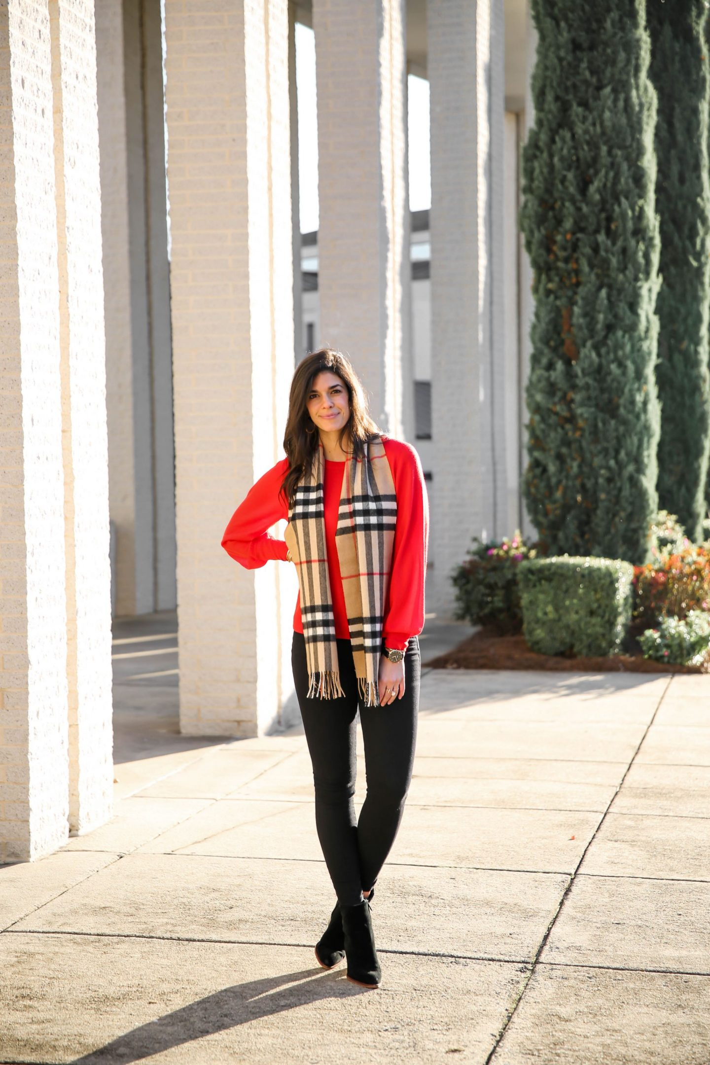 black skinny jeans, red balloon sleeve sweater, Burberry scarf - Laurens Schwaiger Style Blog